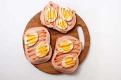 Ketchup sandwich with salami and boiled eggs on a kitchen wooden Royalty Free Stock Photography