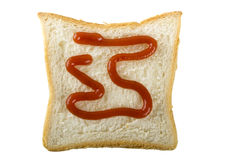 Ketchup and slice of bread Stock Image