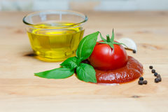 Ketchup tomato basil olive oil herbs garlic board black pepper ingredients Royalty Free Stock Photos
