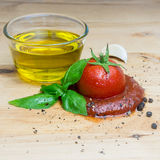 Ketchup tomato basil olive oil herbs garlic board black pepper ingredients square Stock Photo
