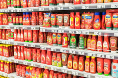 Ketchup Tomato Sauce Bottles On Supermarket Shelf. BUCHAREST, ROMANIA - MARCH 15, 2015: Ketchup Tomato Sauce Bottles On Supermarket Shelf royalty free stock image