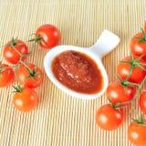 Ketchup and tomatoes. Stock Photo