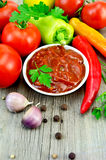Ketchup with vegetables and spices on an old board Royalty Free Stock Photos