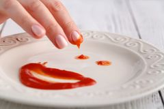 Only ketchup on white plate, tomato souce royalty free stock photo