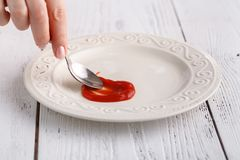 Only ketchup on white plate, tomato souce. Only ketchup on white plate, tomato sauce Royalty Free Stock Image