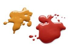 ketchupsenapfärgstänk royaltyfri foto