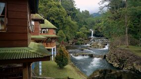 Ketenger Tourism Village with waterfall in Baturraden. Ketenger Tourism Village at river with waterfall in Baturraden, Indonesia stock video