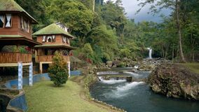 Ketenger Tourism Village with waterfall in Baturraden. Ketenger Tourism Village at river with waterfall in Baturraden, Indonesia stock video footage