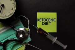 Ketogenic Diet text on top view black table with blood sample and Healthcare/medical concept royalty free stock image