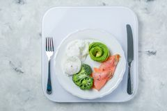 Ketogenic food concept - plate with keto food on weights Royalty Free Stock Photography