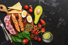 Ketogenic low carbs diet, top view, space for text. Grilled salmon with boiled egg, ham, water with lime,vegetables and stock photo