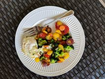 Ketogenic Vegetables and Eggs. Ketogenic organic breakfast or brunch option consisting of colorful mixed vegetables, including broccoli, rainbow carrots, grape Stock Images