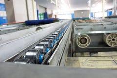 Kettenunterstützung für Paletten-Fördererlinie Lizenzfreies Stockfoto