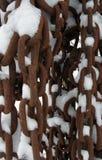 Kettingen en sneeuw Stock Foto's