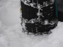 Kettings tryre sneeuw Stock Foto's