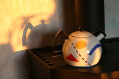 Kettle. Merry kettle on a stove stock photo