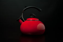 Kettle. Red kettle against a black background Royalty Free Stock Photo
