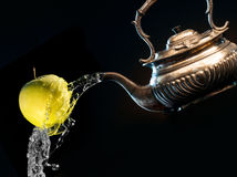 Kettle and apple Royalty Free Stock Images