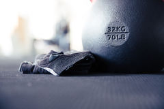 Kettle ball and sports gloves Royalty Free Stock Photography