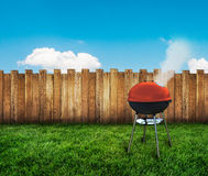 Kettle barbecue grill. On backyard Stock Photography