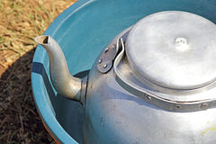 Kettle and basin used as camping equipment Royalty Free Stock Photos