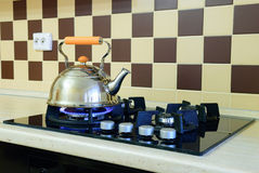 Kettle basking in the modern gas stove Royalty Free Stock Photo
