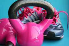 Kettle Bell Beside Adidas Pair of Shoes Stock Images