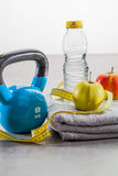 Kettle bell, measuring tape, apples and water for fit healthcare Royalty Free Stock Images