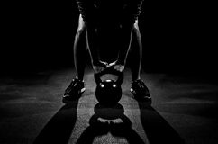 Kettle Bell Work. Working out with kettle bells Stock Images