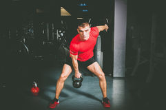Kettle bell workout in the gym. Stock Photo