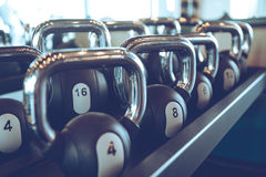 Kettle bells. Close-up of kettle bells lying on shelf at gym stock photography