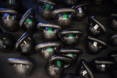 Cast iron kettle bells on the floor of a CrossFit Gym Royalty Free Stock Photo