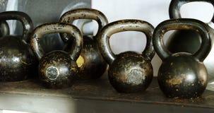 Kettle bells kept on the shelf in the fitness studio 4k