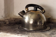 Kettle is boiling on firewood stove. Stock Photo