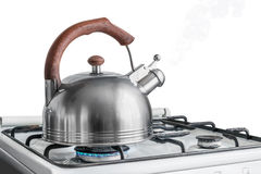 Kettle boiling on a gas stove Royalty Free Stock Photography