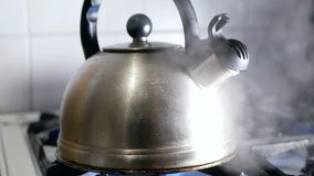 Kettle boiling hot stove. Kettle boiling on a gas stove hot stock footage