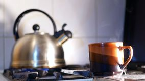 Kettle boiling hot stove. Kettle boiling on a gas stove hot stock video footage