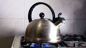 Kettle boiling hot stove. Kettle boiling on a gas stove hot stock video