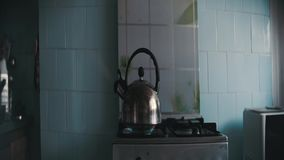 Kettle boiling on the stove stock video footage