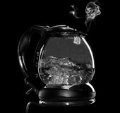 Kettle with boiling water and steam isolated Royalty Free Stock Photography