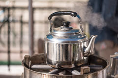 Kettle with boiling water and steam Royalty Free Stock Photos