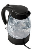 Kettle boils. In the electric kettle water boils stock photo