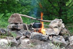 Kettle on the bonfire. Trekking in the Crimea. Waiting for evening tea stock photos