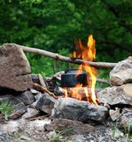 Kettle on bonfire. Trekking in Crimea. Waiting for evening tea royalty free stock images