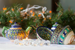 Kettle and bowls, Tajik dishes, Christmas decorations, candles Royalty Free Stock Image