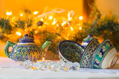 Kettle and bowls, Tajik dishes, Christmas decorations Royalty Free Stock Photo