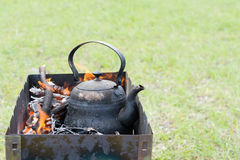Kettle in the burning coals. Kettle of burning coals on the grill Royalty Free Stock Images