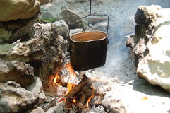 Kettle on a camp fire Stock Images