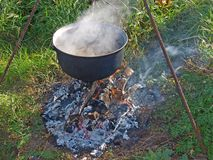 Kettle on campfire Royalty Free Stock Image