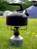 Kettle on camping gas stove Stock Photography